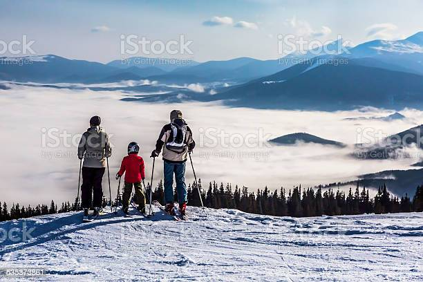 Photo of People observing mountain scenery.