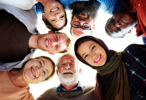 people of different ages and nationalities having fun together - religion stock pictures, royalty-free photos & images