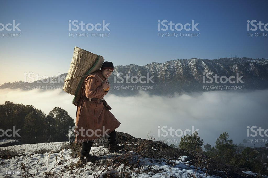 People of Himachal Pradesh: young man in snow capped mountains stock photo