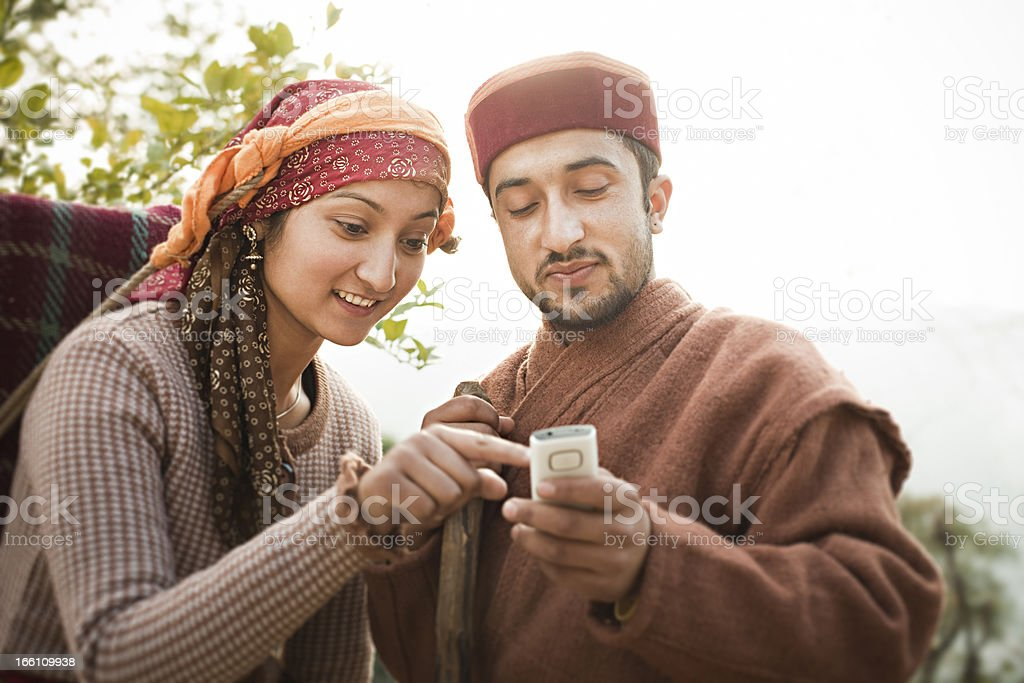 People of Himachal Pradesh: young women and man using phone stock photo