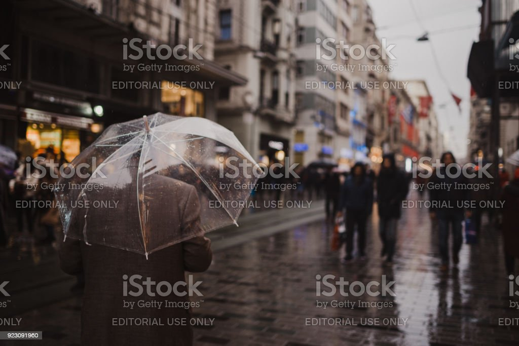 People of Istanbul are walking in a rainy day in Taksim, Istanbul,Turkey stock photo
