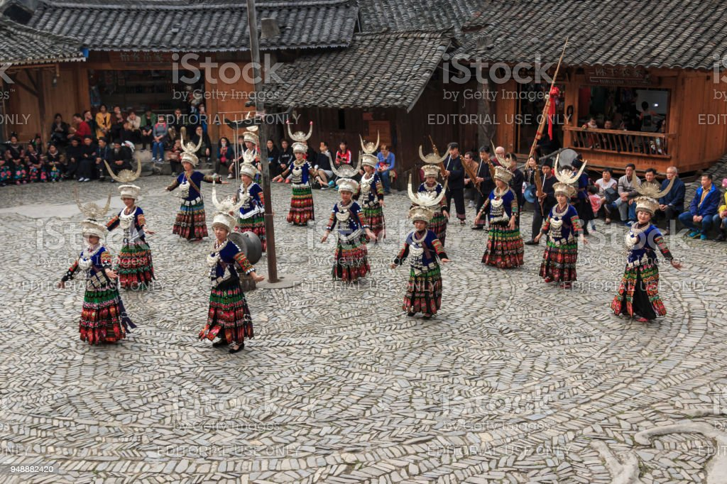 People of the Miao ethnic minority performing a traditional dance in Langde Miao Nationality  village, Guizhou province, China stock photo