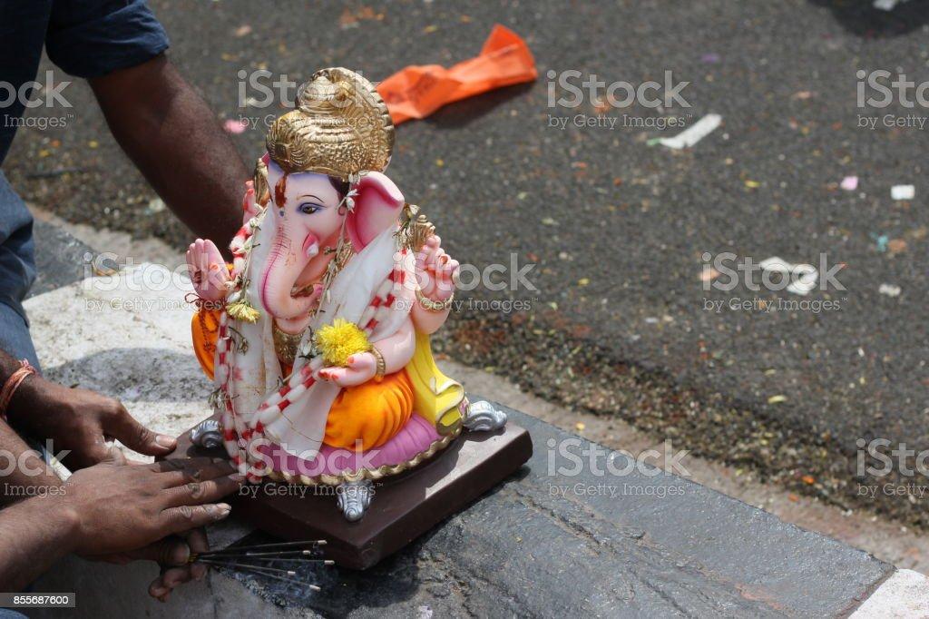 People offer prayers to Hindu God Ganesha Idol Before immersing in water body stock photo