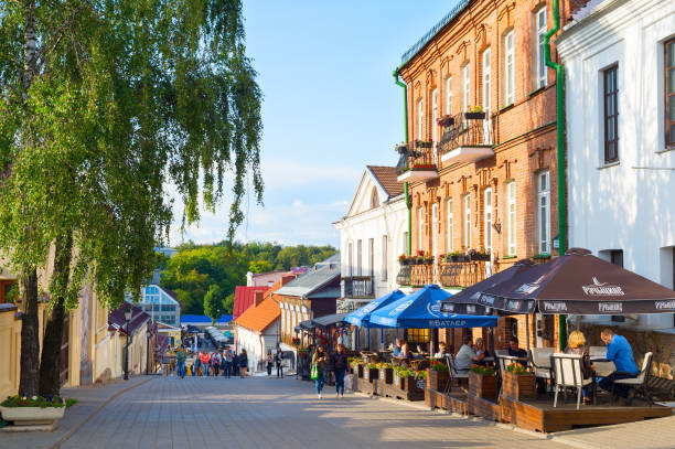 People Old Town street Minsk People walking and sitting at restaurants on an Old Town street of Minsk. belarus stock pictures, royalty-free photos & images
