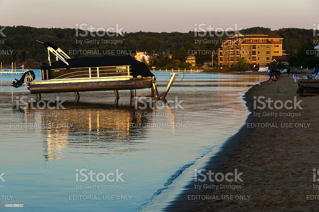 People on a beach in Traverse City, Michigan stock photo