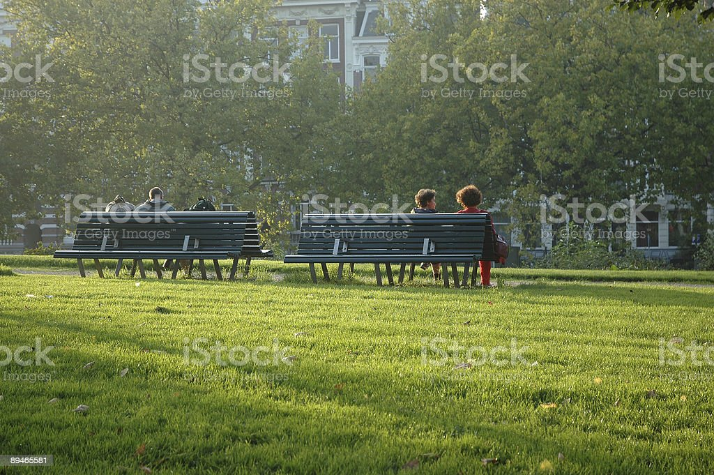 people on a bench in Amsterdam royalty-free stock photo