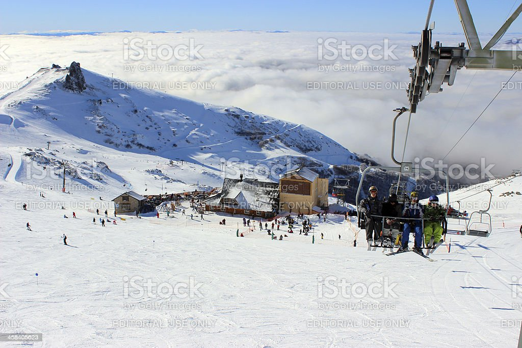People on a chair lift -ski station at CERRO CATEDRAL royalty-free stock photo