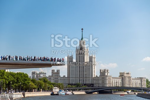 Moscow, Russia - May 13, 2018: People on a floating bridge in the landscape park Zariadye