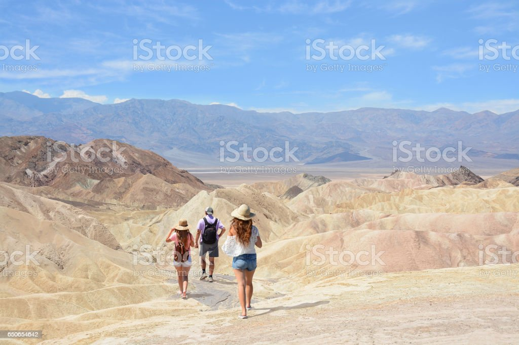 People on a hiking trip in mountains. stock photo