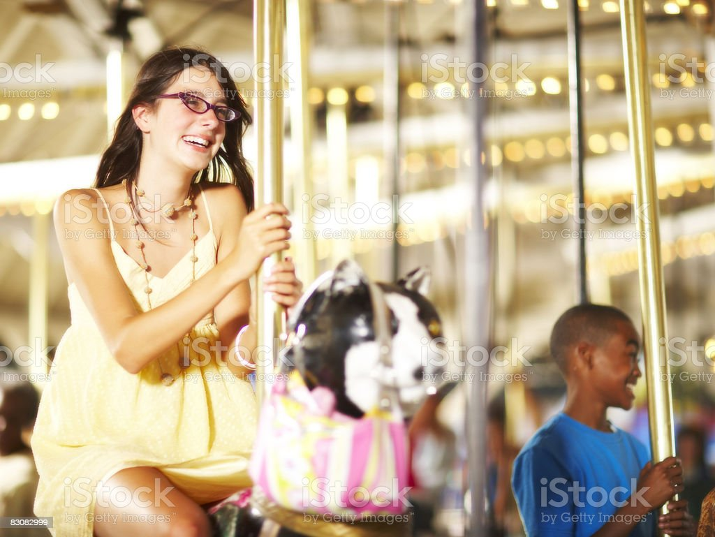 people on a merry go round royalty free stockfoto