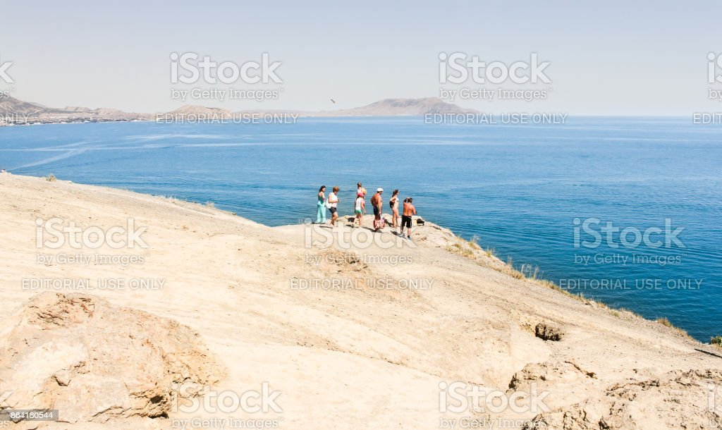 People on a plateau over the sea. royalty-free stock photo