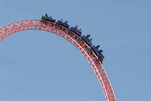 people on a rollercoaster - roller coaster stock pictures, royalty-free photos & images