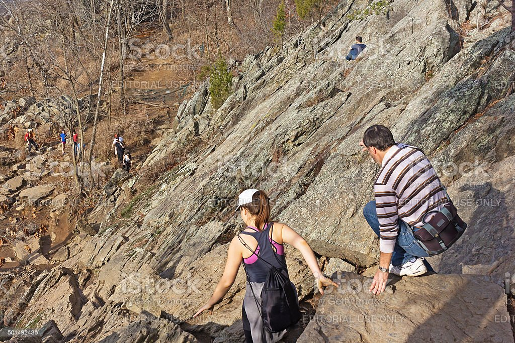 People on a strenuous hike in Great Fall Park. stock photo