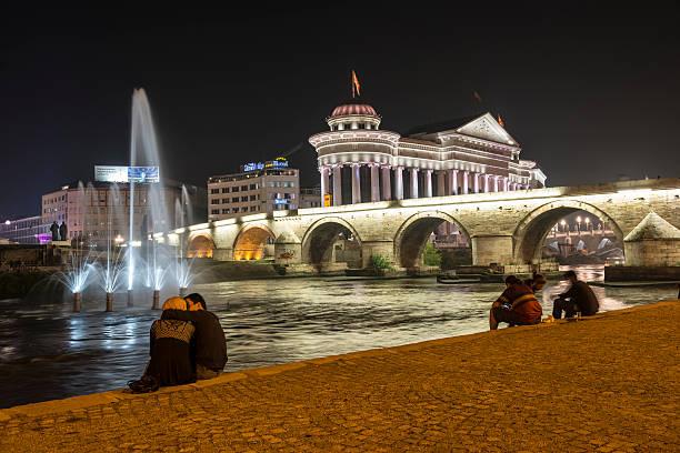 people on a summer night in skopje, macedonia - üsküp stok fotoğraflar ve resimler