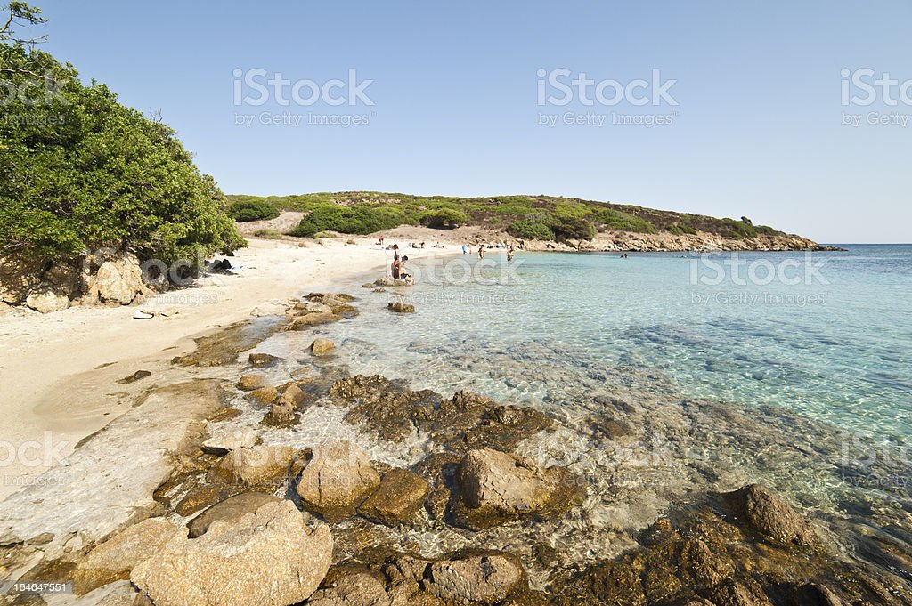 People on a wild Beach in Sardinia royalty-free stock photo