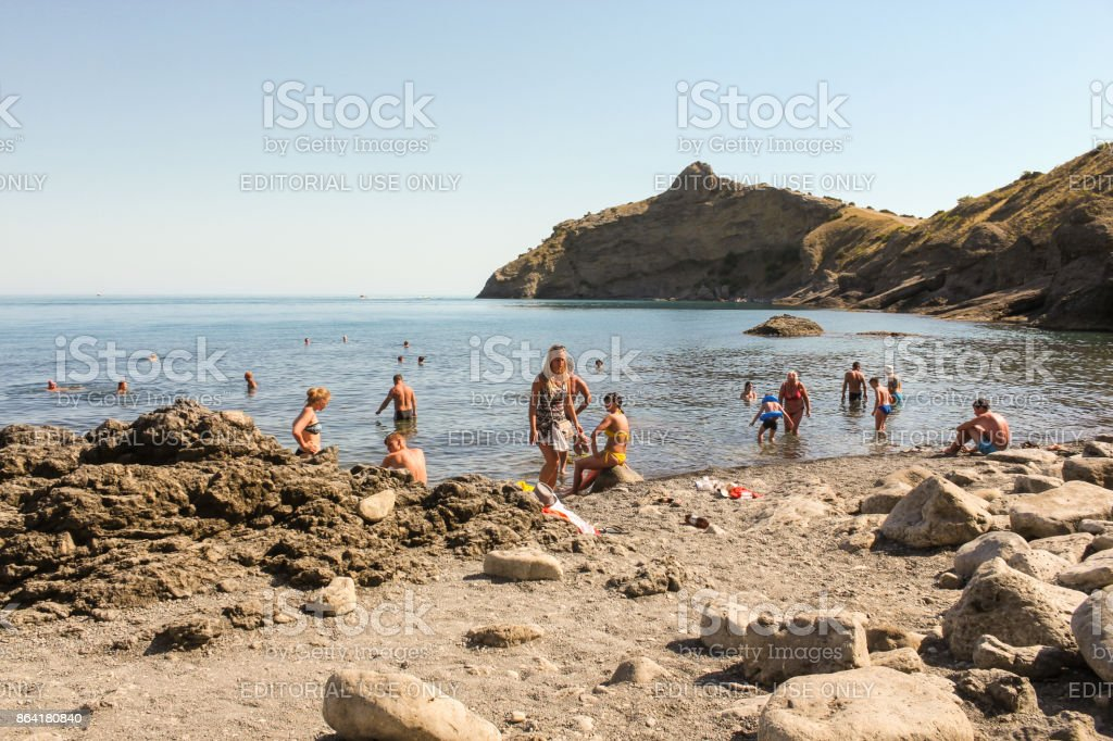 People on a wild beach. royalty-free stock photo