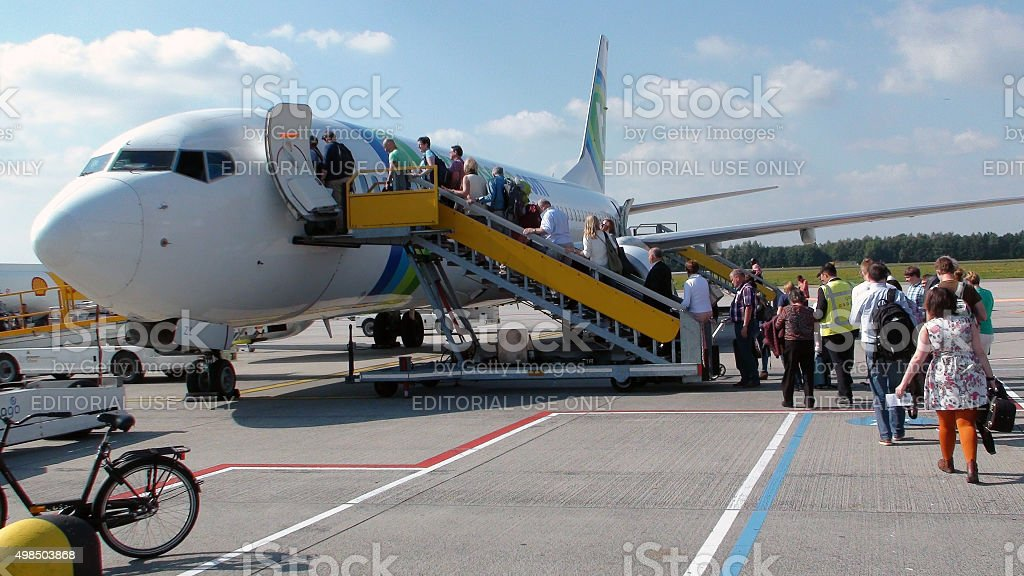 People On Airplane Staircase Queuing In Line To Board Transavia.Eindhoven.Airport stock photo
