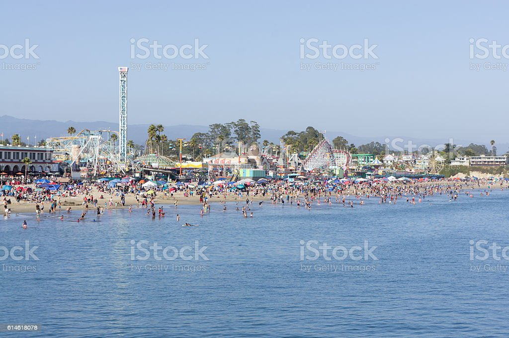 People on beach and amusement park at the Boardwalk stock photo
