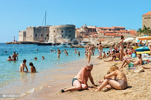 istock People on beach at Adriatic Sea and Dubrovnik fort 691293512