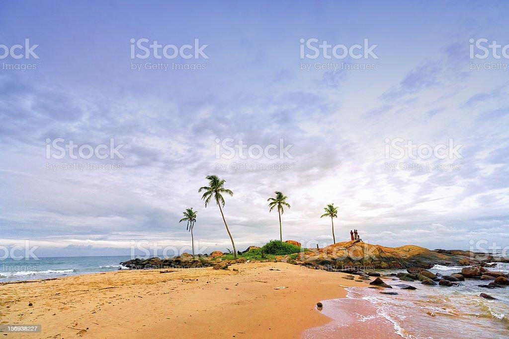 People on Beach enjoying Sunset stock photo