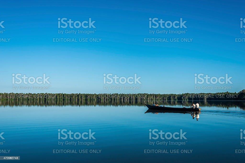 people on boat peruvian Amazon jungle Madre de Dios Peru stock photo