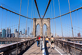 New York, United States of America - September 22, 2019: People walking on the promenade of the famous Brooklyn Bridge