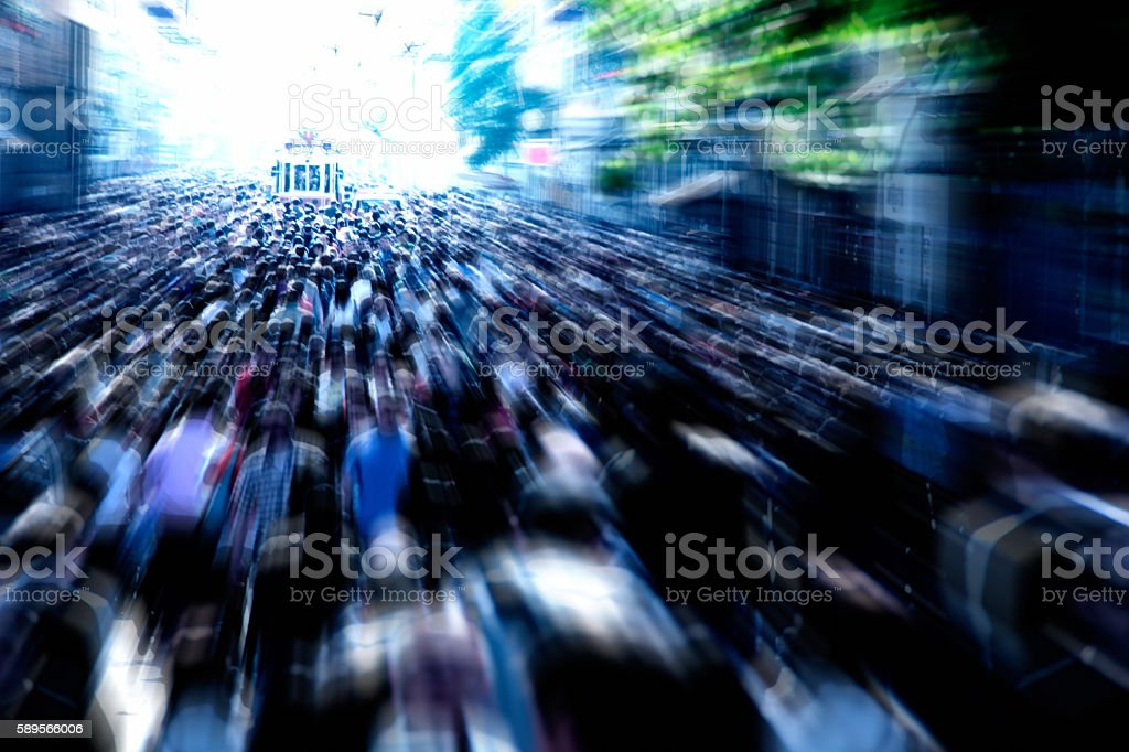 people on busy street stock photo