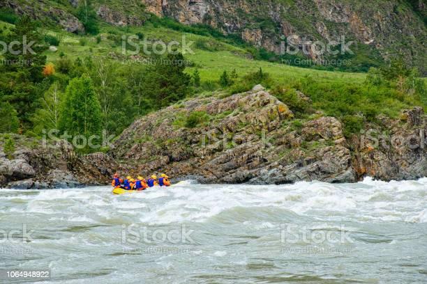 Photo of People on canoe kayaking in Katun River in Altai