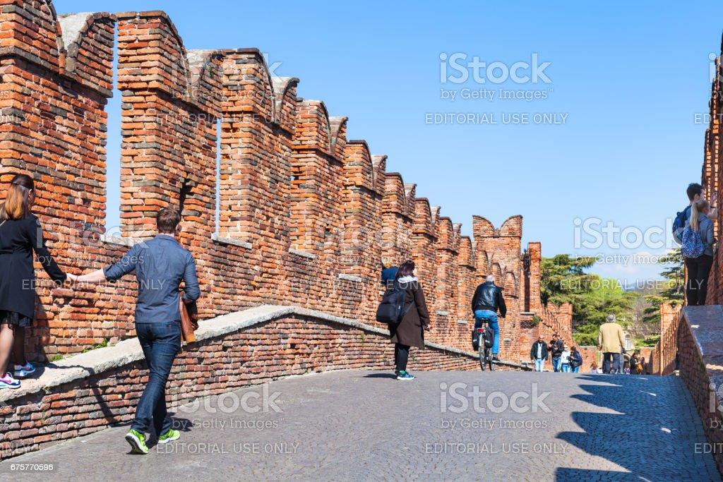 people on Castelvecchio (Scaliger) Bridge stock photo