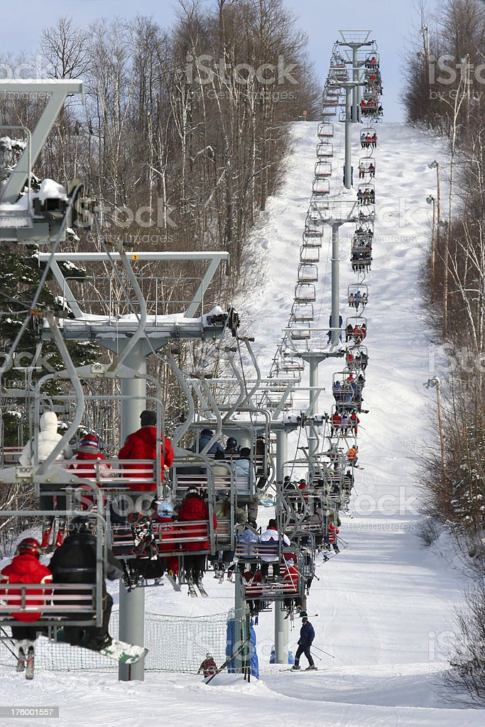 People on chair lift during a afternoon snow ski royalty-free stock photo