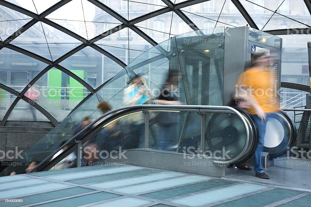 People on Escalator Exiting Subway Station royalty-free stock photo