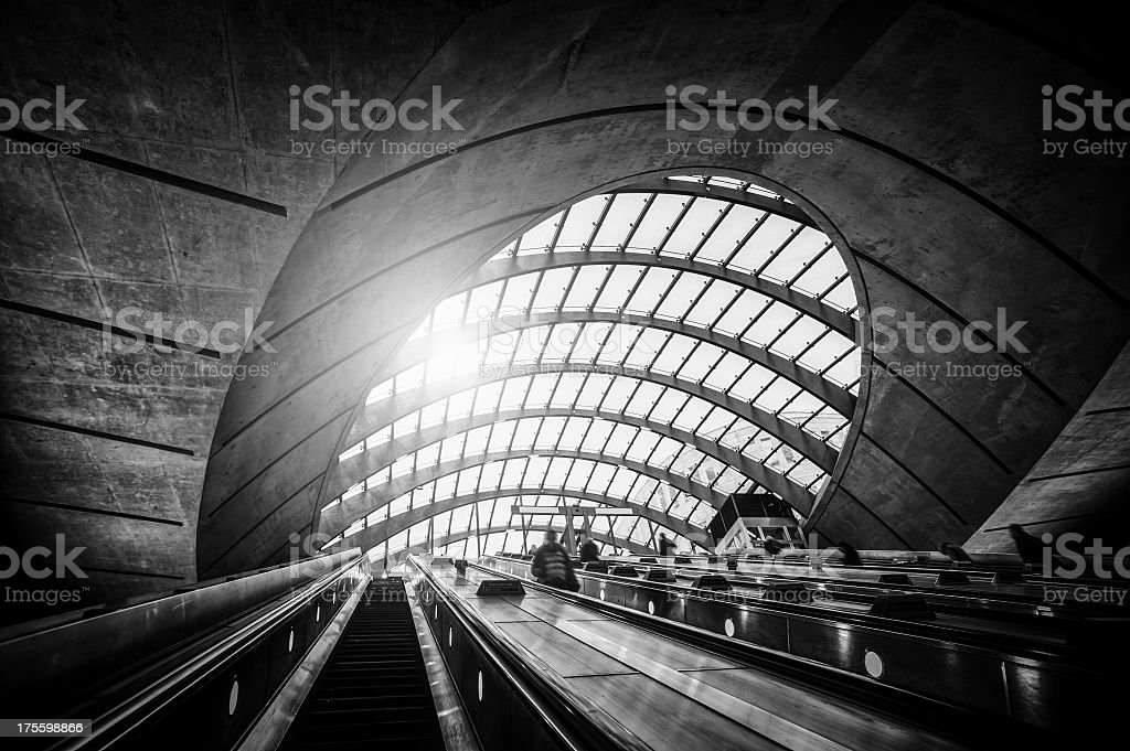 People on escalator in subway station at Canary Wharf, London stock photo