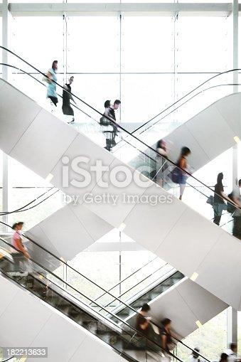 istock People on Escalator 182213633