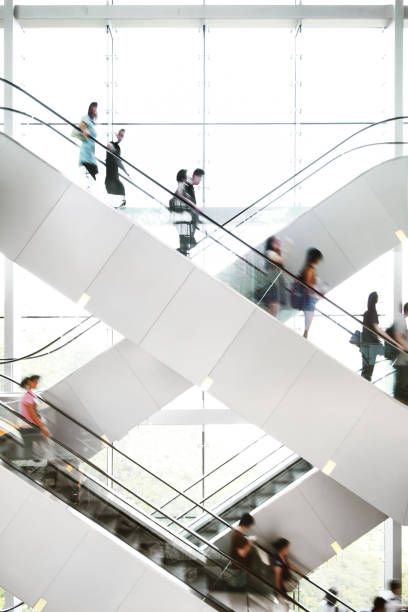 people on escalator - shopping mall stock photos and pictures