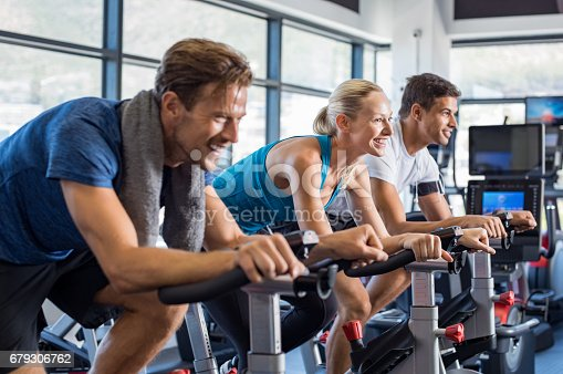 istock People on exercise bike 679306762