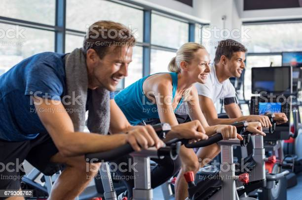 People on exercise bike picture id679306762?b=1&k=6&m=679306762&s=612x612&h=0aqawjyjhbqwpsyz8x 6nmmh4q8 wbdpctigaqwmjw8=