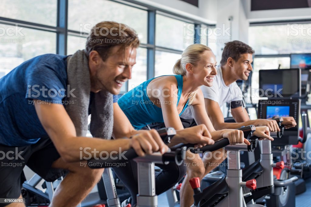 People on exercise bike stock photo