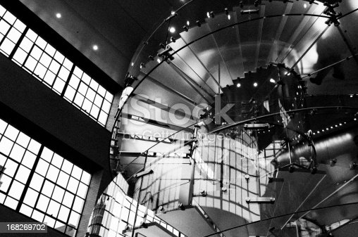 180698194 istock photo People on Glass Staircase, NYC. Black And White. 168269702