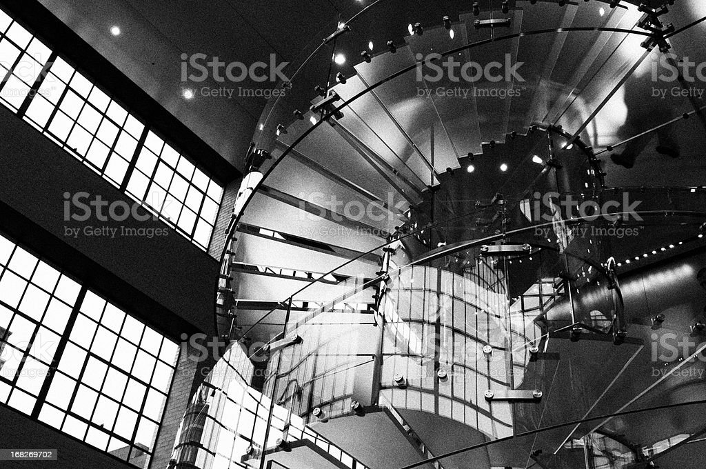 People on Glass Staircase, NYC. Black And White. stock photo