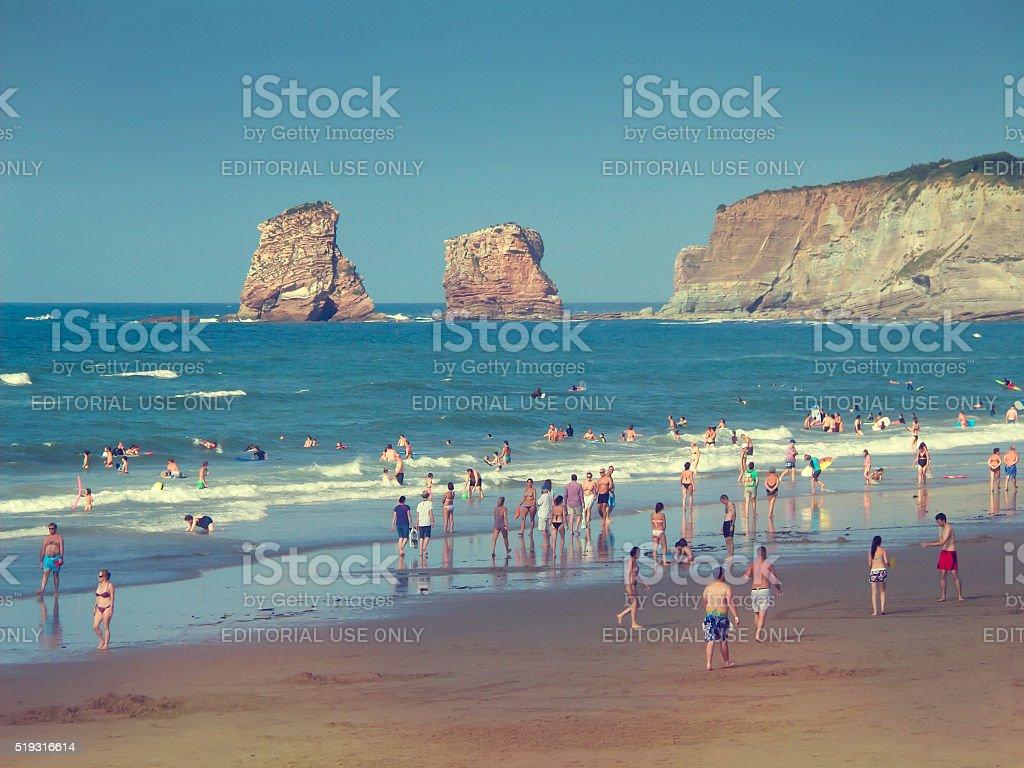 People on Hendaye beach in France stock photo