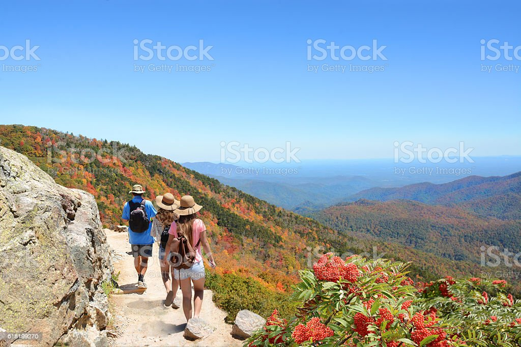 People on hiking trip in beautiful autumn mountains. stock photo
