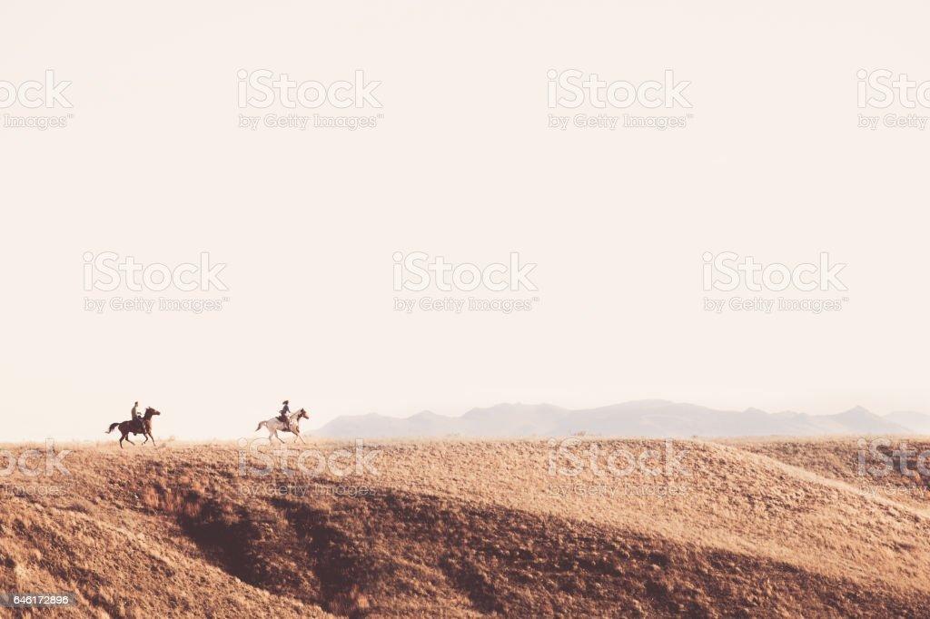 People On Horseback Outdoors stock photo