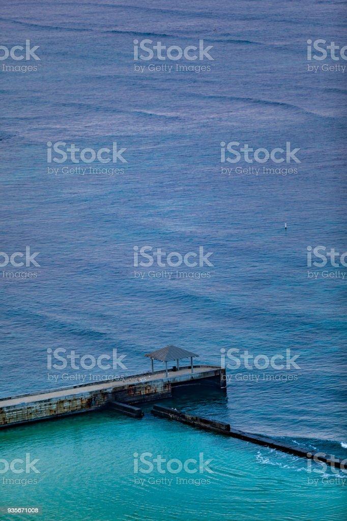 people on jetty at waikiki beach, honolulu, oahu island stock photo