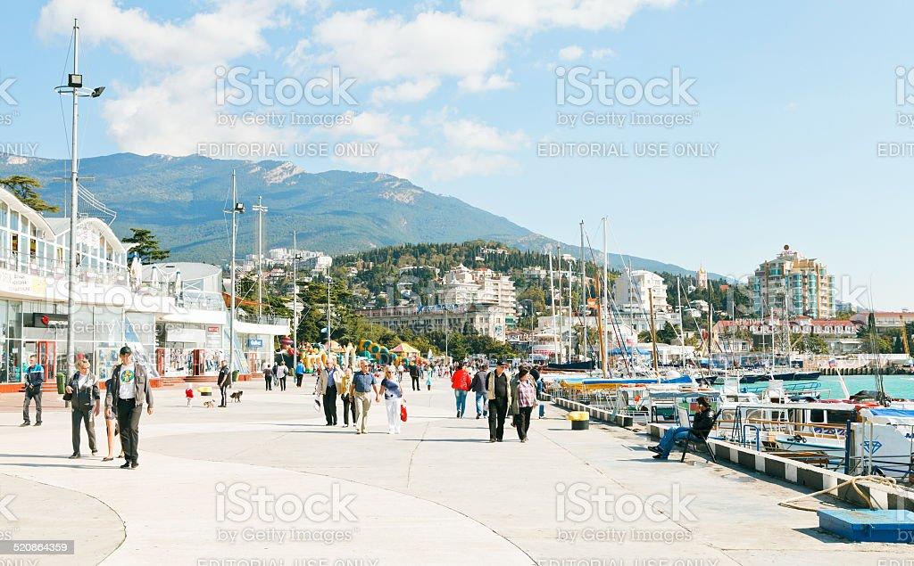 people on Lenin embankment in Yalta in September stock photo