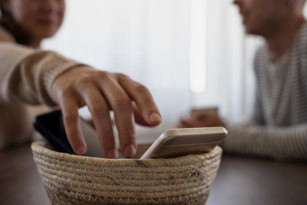 People on meeting without their phones. Digital detox, basket