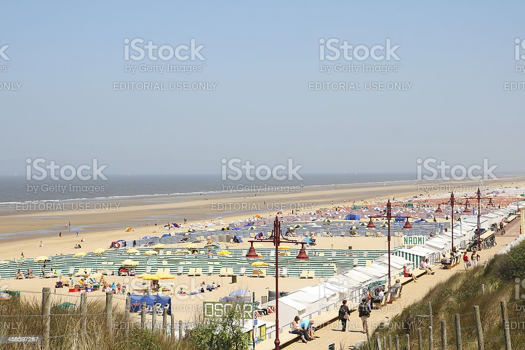 People on north sea beach at De Haan in Begium​​​ foto