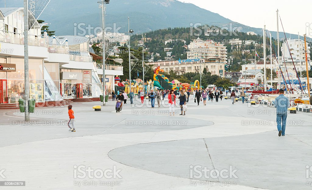 people on promenade in Yalta city in evening stock photo