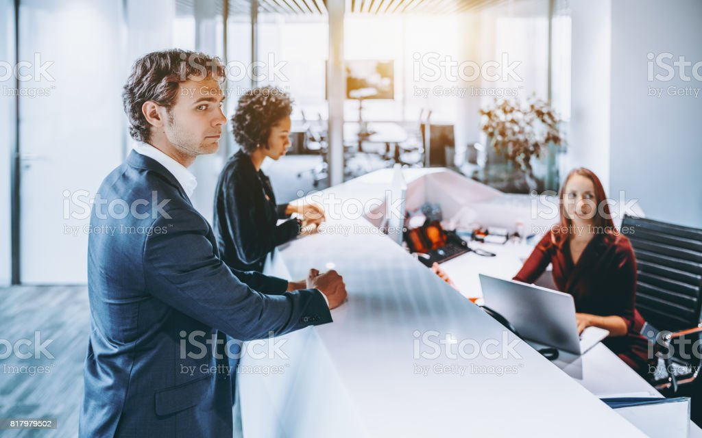 People on reception of business office stock photo