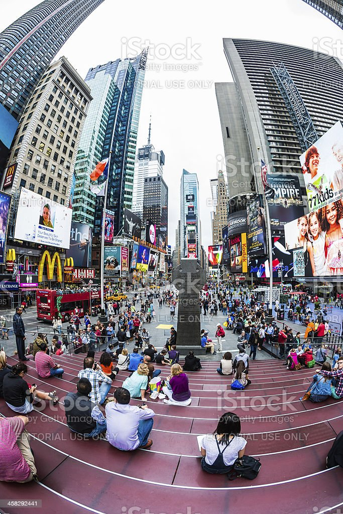 People on red steps at Times Square, New York City stock photo