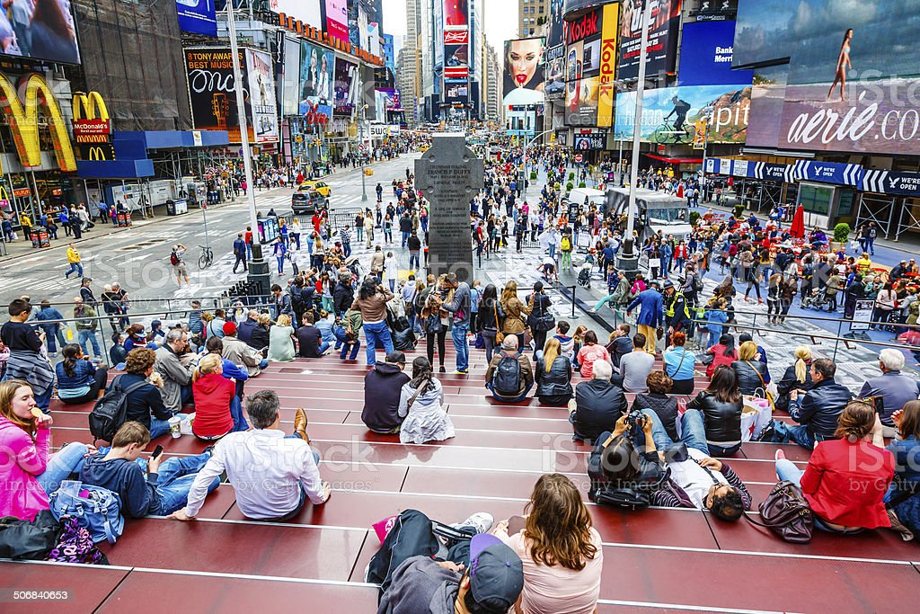 People on red steps, Times Square, New York City stock photo